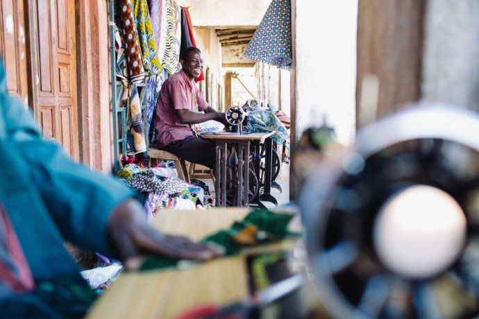 Malawi: A man works on his sewing machine along the road in Malawi. Photo by Doseong Park. More Info