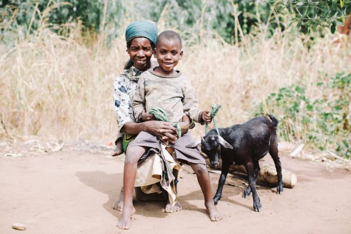 Malawi: A family poses with their goat, given to them by an OM-run school in Malawi. Goats help provide fertilizer for gardens as well as meat. Photo by Doseong Park. More Info
