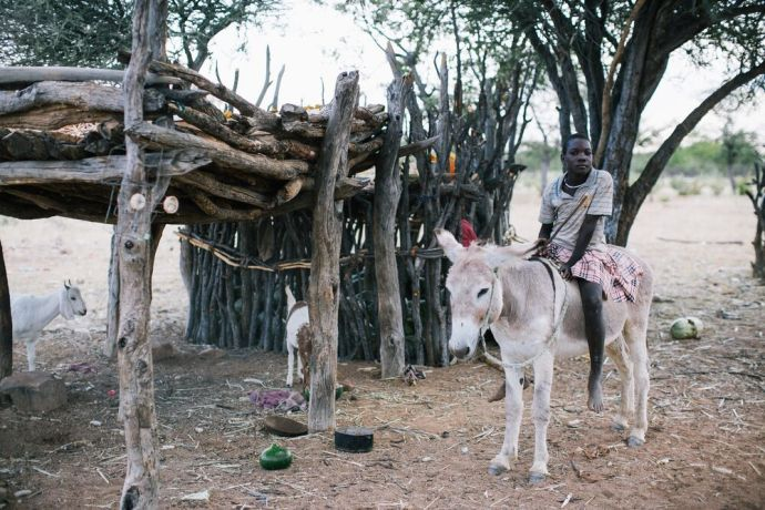 Namibia: A man sitting on a donkey poses for a photo in Namibia. Photo by Doseong Park. More Info