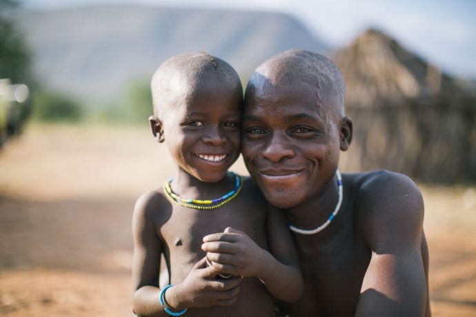 Namibia: A young man and a smiling boy pose for a photo in Namibia. Photo by Doseong Park. More Info
