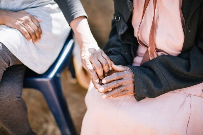 South Africa: A woman offers her hand in comfort at an outreach in South Africa. Photo by Doseong Park. More Info