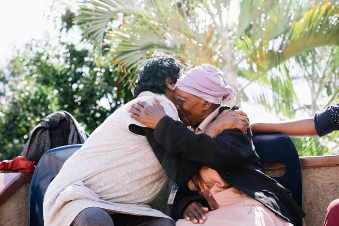 South Africa: Two women hug while on outreach in South Africa. Photo by Doseong Park. More Info