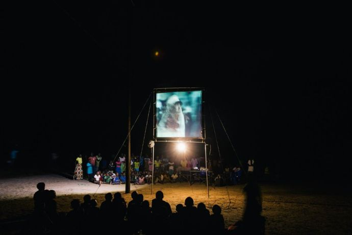 Mozambique: The Jesus Film is shown in the local language at a village in Mozambique using a generator. Photo by Doseong Park. More Info