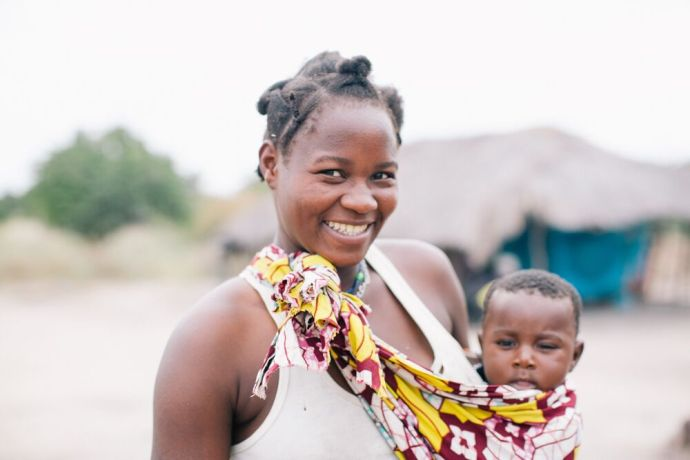 Mozambique: A woman smiles while holding her child in Mozambique. Photo by Doseong Park. More Info