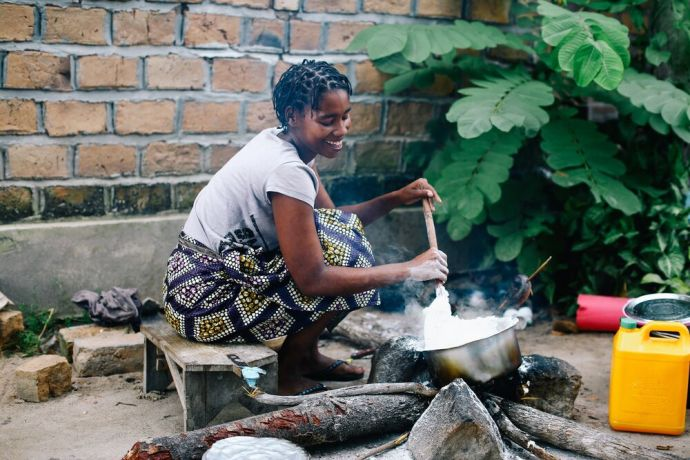 Mozambique: A woman cooks over a fire in Mozambique. Photo by Doseong Park. More Info