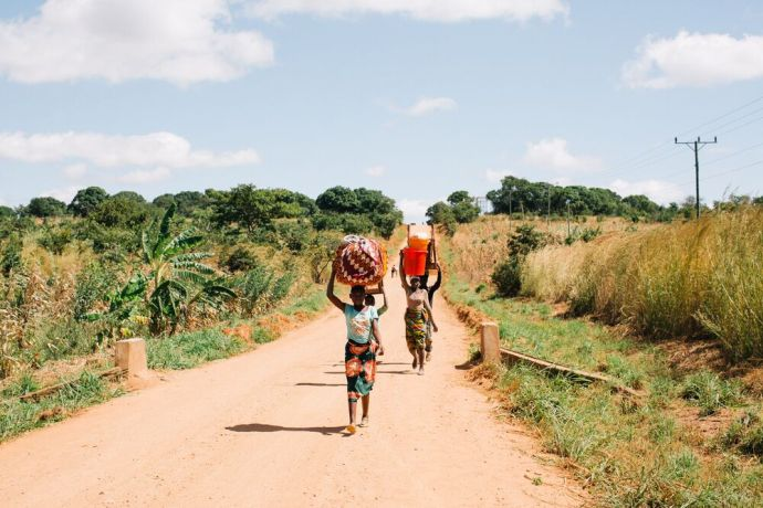 Mozambique: A group of women carry bundles down a road in Mozambique. Photo by Doseong Park. More Info