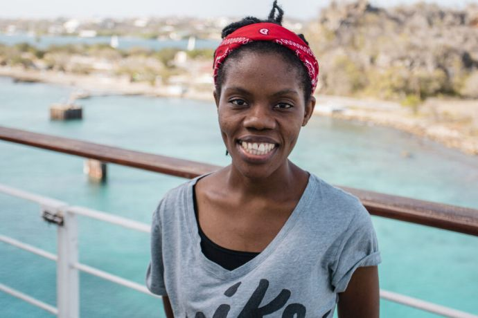 Curaçao: Caracas Bay, Curaçao :: Izzy Alexandre (Haiti) on the outer deck of Logos Hope. More Info