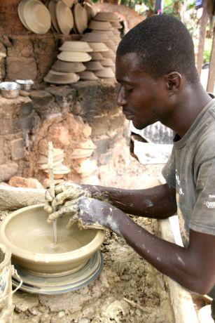 Ghana: A man creates a clay bowl. Photo by Anita Gehring. More Info