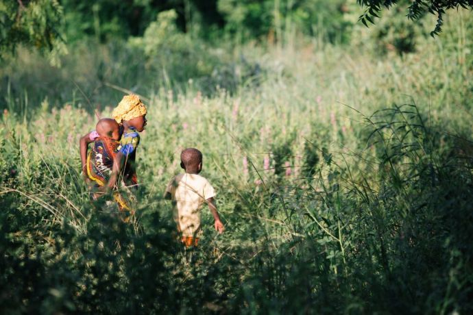 Ghana: Children walk into the bush in Ghana. Photo by Do Seong Park. More Info