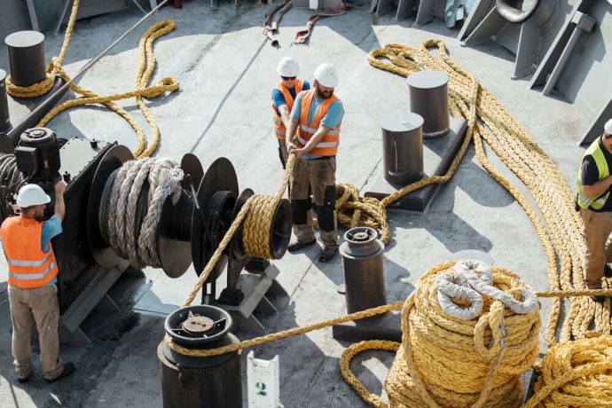 Jamaica: Kingston, Jamaica :: Deck crew prepare the mooring lines for shifting the ship. More Info