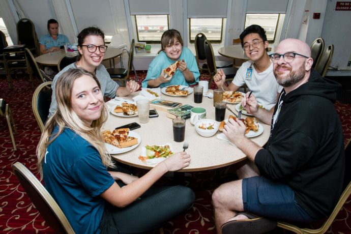 Jamaica: Kingston, Jamaica :: Crewmembers enjoy a special meal together. More Info