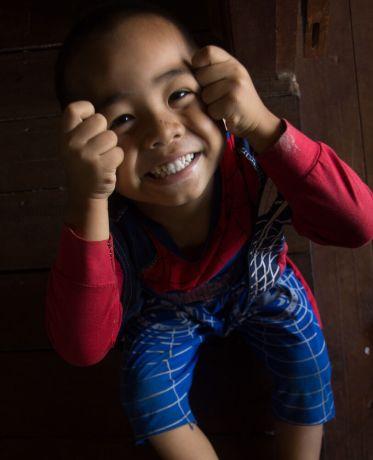 Myanmar: Happy boy in Myanmar wearing a Spider-Man outfit. Photo by Ellyn Schellenberg. More Info