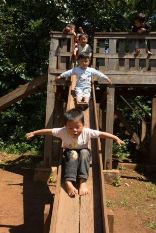 Myanmar: Children going down a slide in Myanmar. Photo by Ellyn Schellenberg. More Info