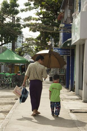 Myanmar: A man and boy walk down a footpath in Myanmar. Photo by Ellyn Schellenberg. More Info