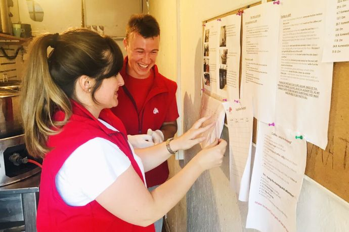 Serbia: Lidia and coworker in an office at refugee camp in Serbia. More Info