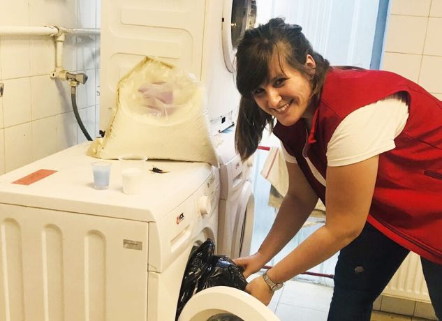 Serbia: Lidia working in a laundry at a refugee camp in Serbia. More Info