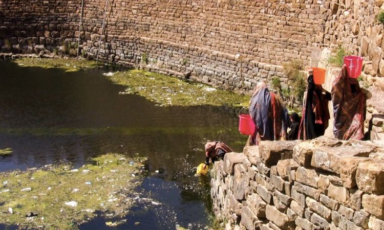 Arabian Peninsula: Women in Yemen walking down stairs to collect water from a reservoir. More Info