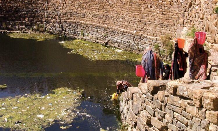 Arabian Peninsula: Women in Yemen walking down stairs to collect water from a reservoir. More Info