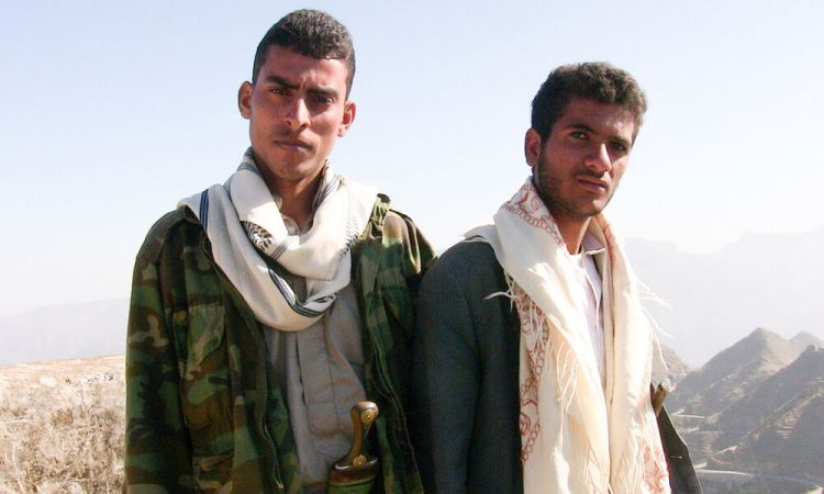 Arabian Peninsula: Two men in Yemen with traditional headgear cloths draped over their shoulders. More Info
