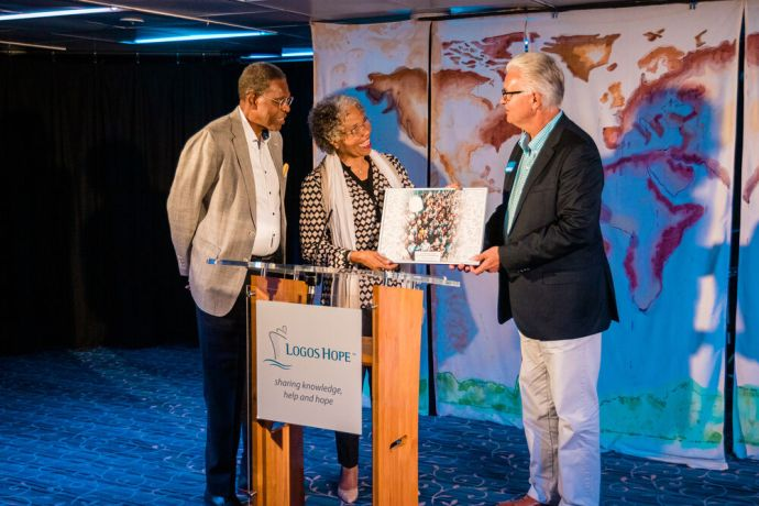 Curaçao: Willemstad, Curaçao :: Ship director Randy Grebe (USA) presents a gift to the islands Governor-General, Lucille George-Wout and her husband, Herman George. More Info