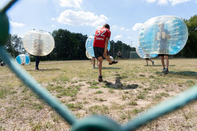 Germany: Teens playing bumper ball at TeenStreet Live. Photo by Achim Schneider. More Info