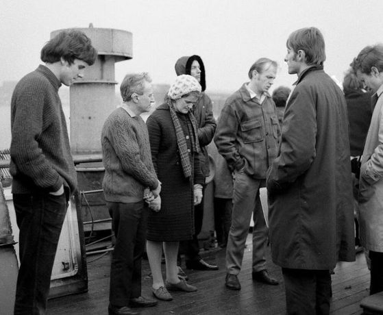 Ships: OM Ships :: OMs founder, George Verwer (second from right) and original crewmembers pray on the deck of Umanak, which would become the Ship Ministrys first vessel, Logos. More Info