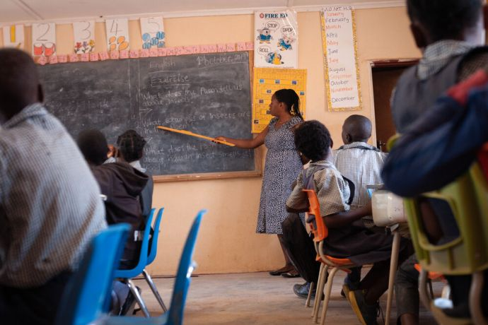 Zambia: Teacher and students in class at Makwati School in Kabwe, Zambia. More Info