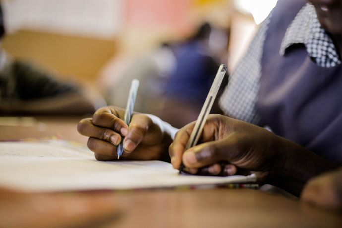 Zambia: Students writing in the classroom at Makwati School in Kabwe, Zambia. More Info