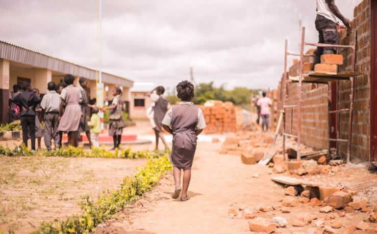 Zambia: Student walking at Makwati School in Kabwe, Zambia. More Info