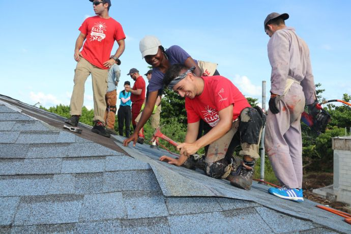 Bahamas: Abaco Islands, Bahamas :: Atipa Kashimoto (centre, Zambia) and Juan Velez (Colombia) help re-roof a hurricane-damaged house. More Info
