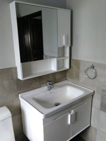 Zambia: Impact Multiplied - A bathroom basin and mirror cabinet in Kabwe, Zambia. More Info