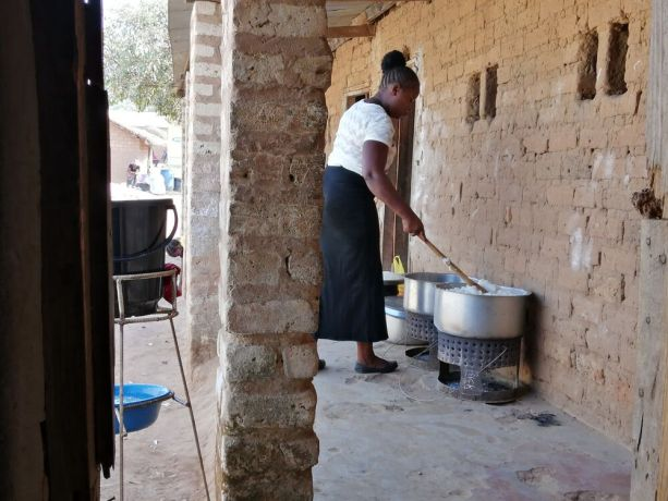 Zambia: Woman cooking at Saikolo Community School in Kasama, Zambia. More Info