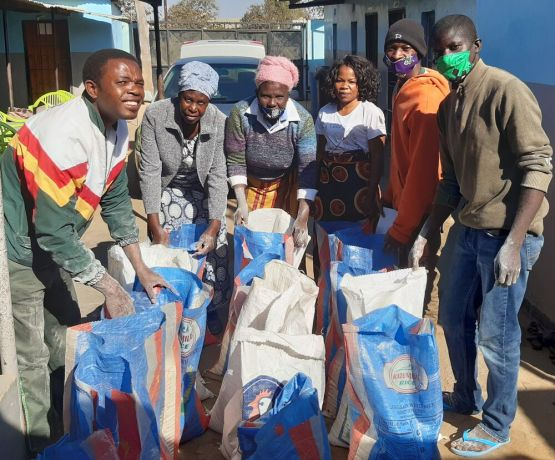 Zambia: Workers providing food at Mercy House ministry in Kabwe, Zambia. More Info