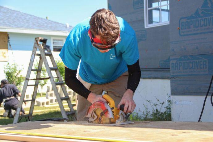 Bahamas: Abaco Islands, Bahamas :: Isaac OShea (Ireland) cuts wood at a construction project to rebuild a hurricane-damaged home. More Info