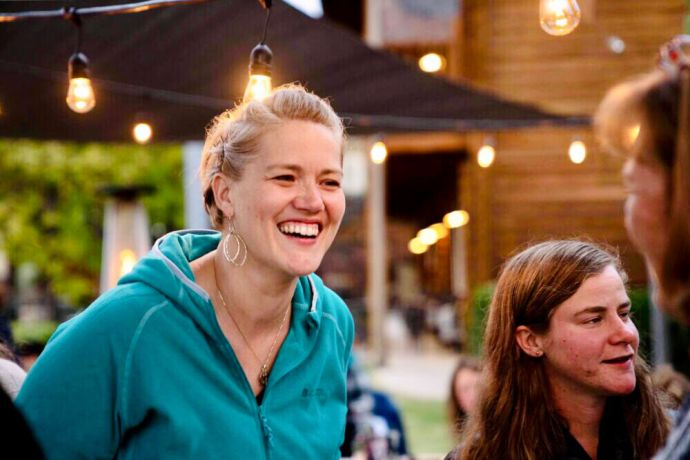 United States: Ruth Willett laughs during a gathering of women at the Freedom Challenge USA Grand Canyon challenge in October 2018. Photo by Alexander Arpag. More Info