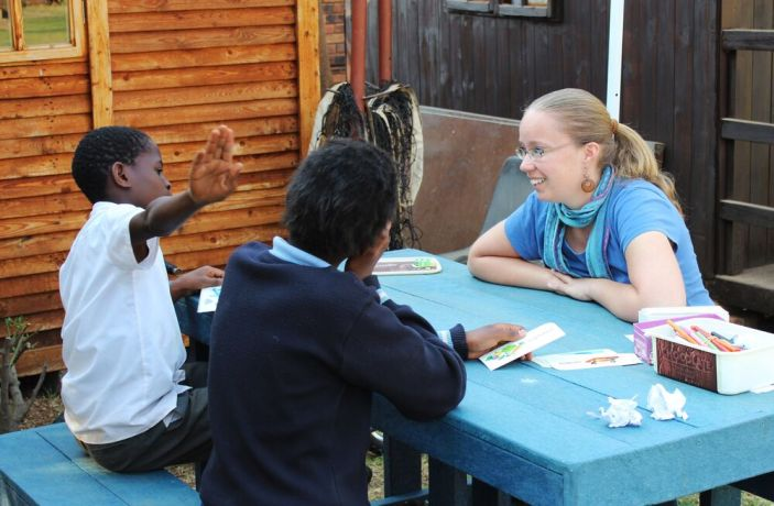 South Africa: Marleen Mortin, Childrens ministry coordinator for the Africa Area, helps children read. More Info