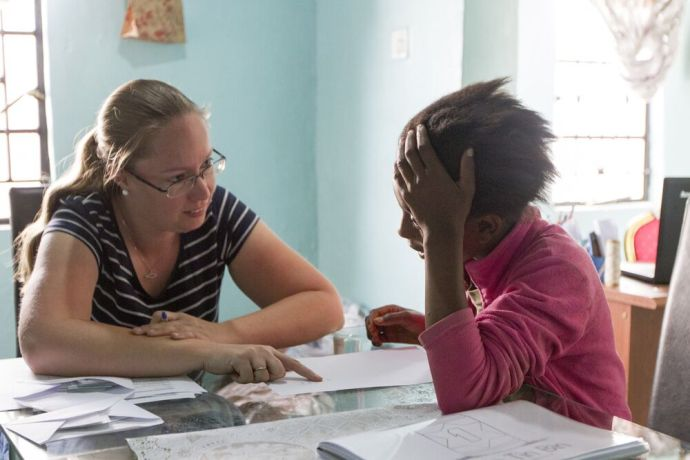 Zambia: Marleen Mortin, Childrens ministry coordinator for the Africa Area, does a reading assessment with a student in Zambia. More Info
