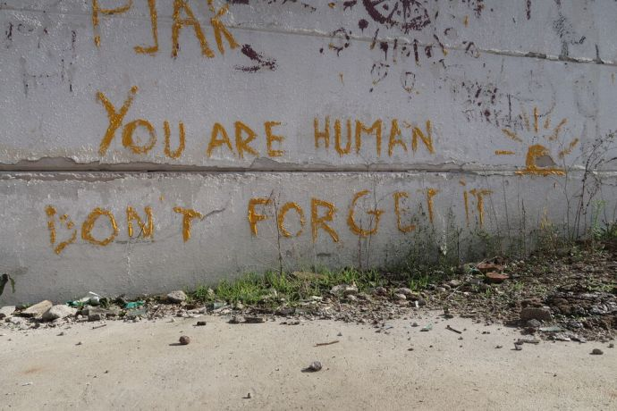 Serbia: Graffiti in disused factory in Šid, Serbia, a former refugee hide-out. Photo by Tillmann Klein. More Info