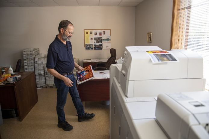 United States: USA Print Operations Specialist Randy Jury using his skills to serve God in a basement print shop. Photo by Adam Hagy. More Info