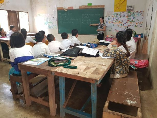 South East Asia: A woman in East Asia teaches her students. More Info