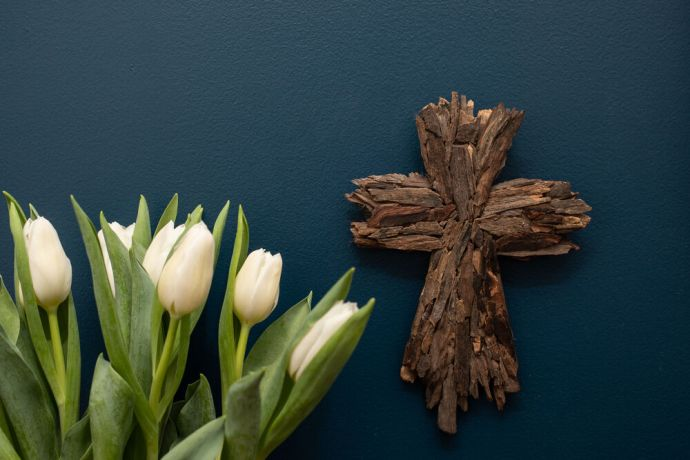International: A cross with tulips. Photo by Rebecca Rempel. More Info