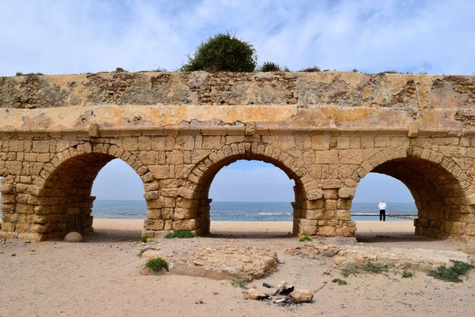 Israel: An ancient Roman aqueduct near Caesarea Maritime. Photo by Kate Toretti. More Info
