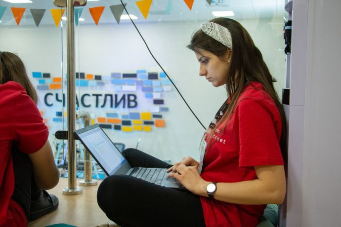 Russia: A young woman working on her computer at the first ever TeenStreet conference held in Russia at the beginning of 2021. More Info