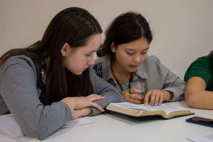 Russia: Young women reading the Bible at the first ever TeenStreet conference held in Russia at the beginning of 2021. More Info