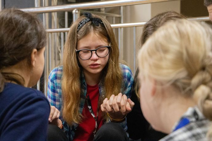Russia: Young women praying together at the first ever TeenStreet conference held in Russia at the beginning of 2021. More Info