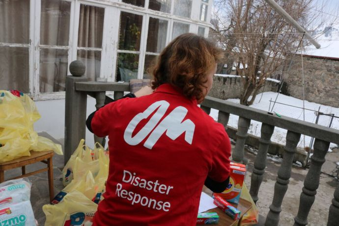 Armenia: An OM International Disaster Response team member packs hygiene supplies for distribution to refugees in Armenia. Photo provided by OM International Disaster Response. More Info