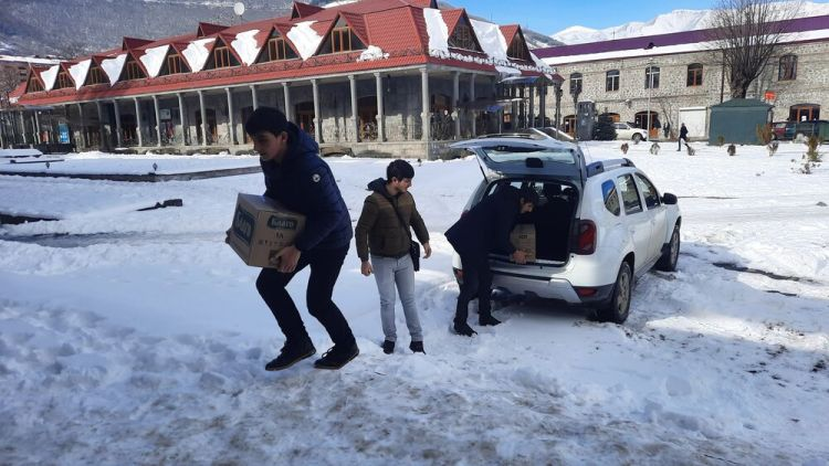 Armenia: Local volunteers assist OM workers in distributing relief supplies for refugees. Photo provided by OM International Disaster Response. More Info