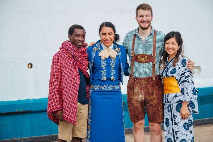 Curaçao: Caracas Bay, Curaçao :: Logos Hope crewmembers in their traditional dress. More Info