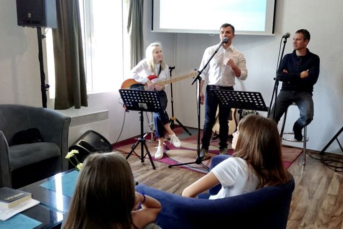 Montenegro: Yan leads a service in OMs church plant Mozaik, Bar, Montenegro. More Info
