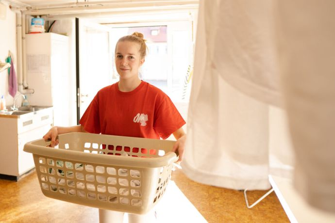 Germany: Young woman doing laundry during her GAP Year. Photo by Achim Schneider. More Info
